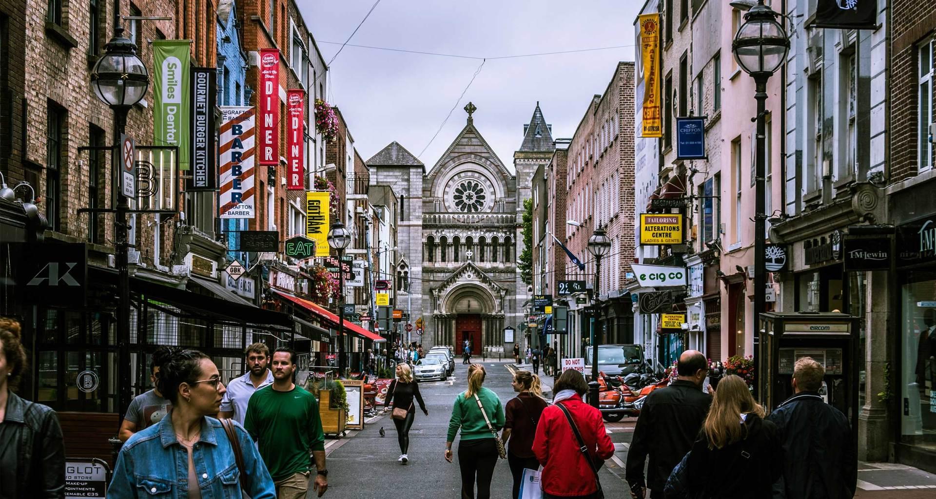 People walking on a city street in Dublin, Ireland.