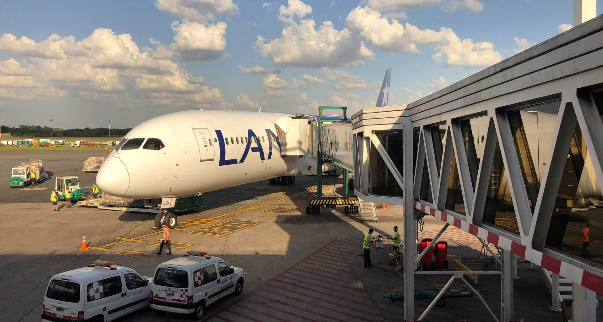 LATAM Airlines Boeing 787 connected to jet bridge at Buenos Aires Airport.