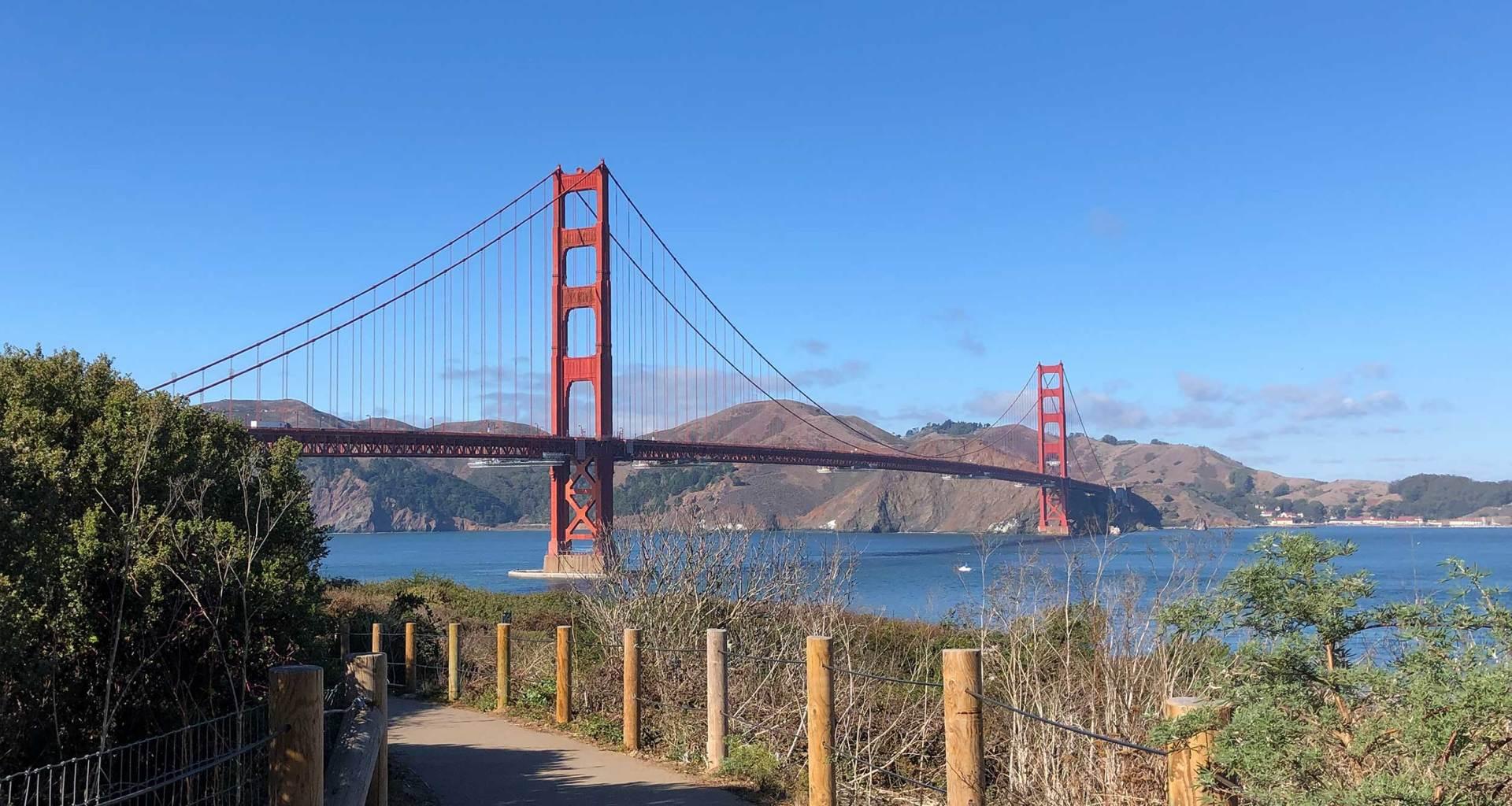 Golden Gate Bridge against a clear blue sky.