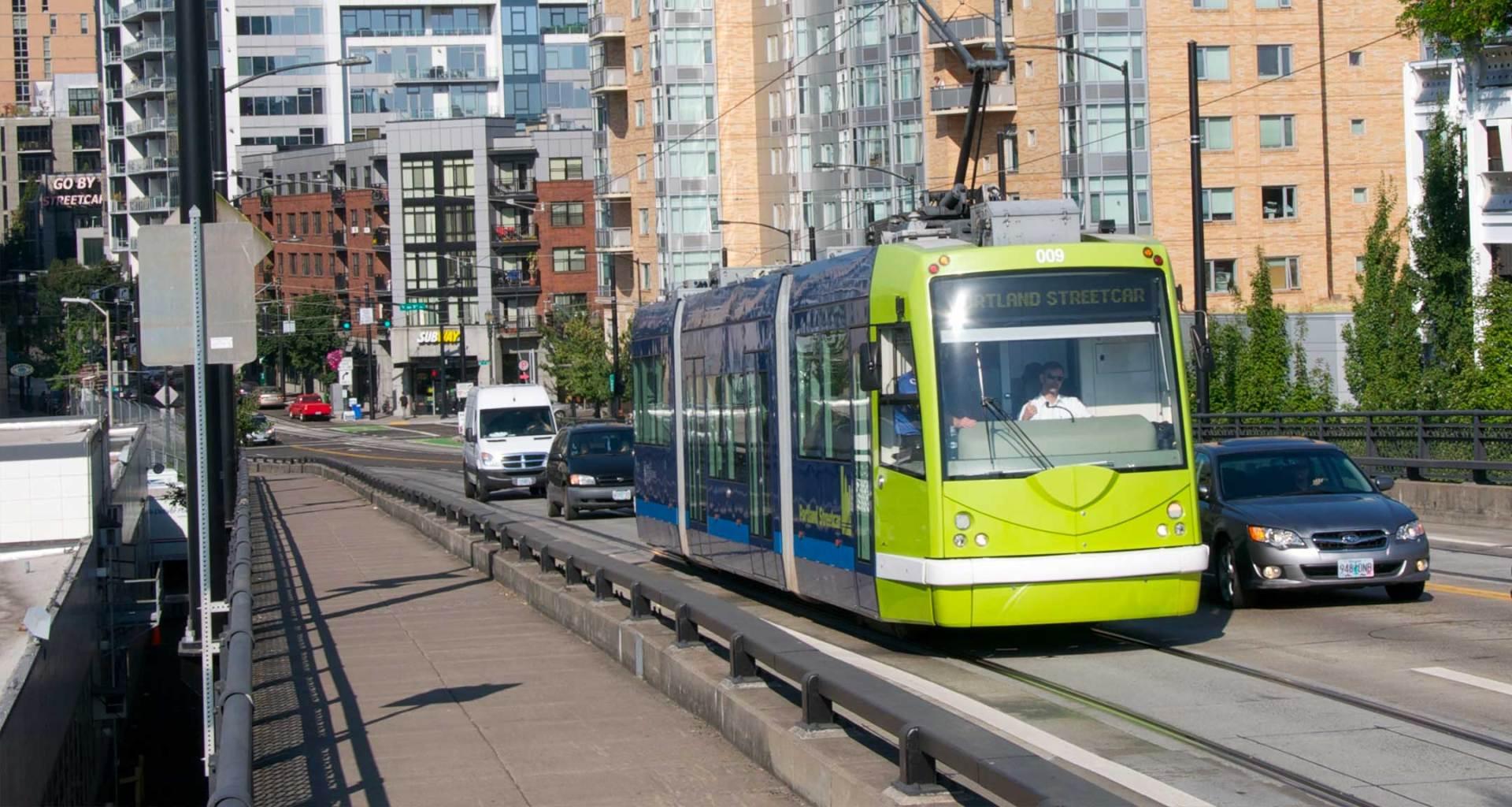 Streetcar rolling amid traffic in Portland, Oregon.