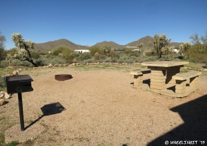 """View of """"sitting area"""" with fire-pit, grill and picnic table. This was from site #55"""