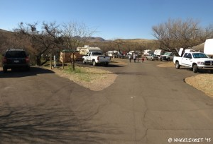 View down middle of East Campground. Car in site #56 on left with #54 behind.
