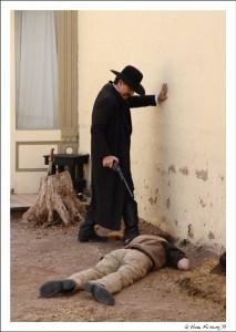 Wyatt Earp gives Billy an extra shot