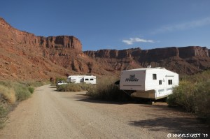 View down back-end of campground. RV in site#15 on right with big rig in #17 behind it.