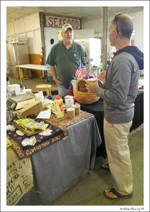 Paul chats to the butcher-block guy at Bandon market
