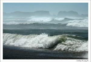 Wild waves crash on the beach on a sunny day
