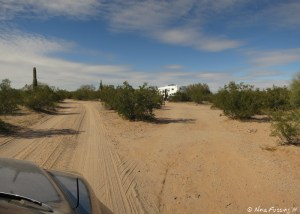 Main road into the wash. RV  in a site on the right