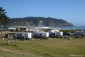 View of RV park from the side. RV's nearest to us are in sites 12-18. We're in the middle of the front-facing row. Beach is in the back ground.