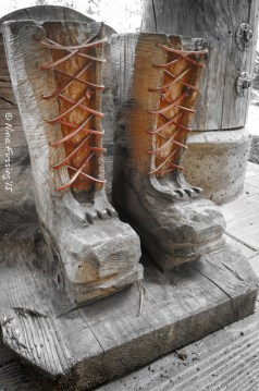 Wood carving of logging boots