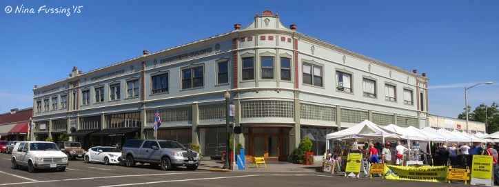Downtown Astoria architecture. The Sunday farmer's market is rocking the tents on the right.