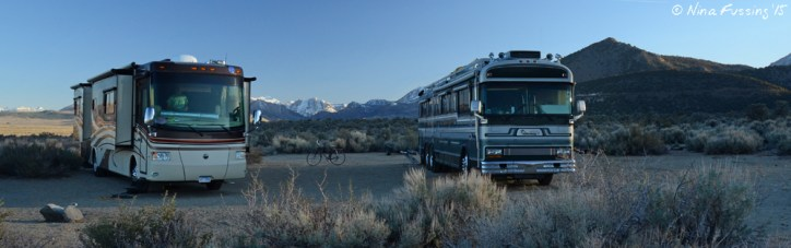 Us boondocking next to the very sexy Bluebird on Hwy 395