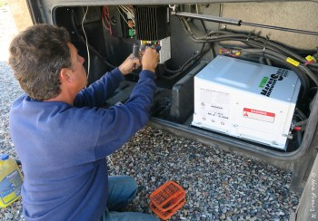 Marv removing our old solar controller & inverter from the external bay