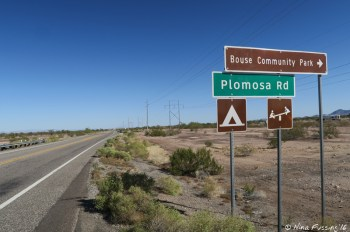 Sign for Plamosa Road as seen from Hwy 95