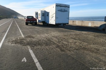 """Back view of """"double wide"""" site #5. You can see the rig is off the end of the pavement and partially on the sand."""
