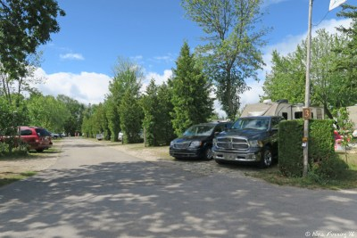 """View down central """"row section"""" of campground. This is row 3 viewed from the front (water-side) end. Site #1076 on right with #1075 behind it."""