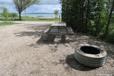 "Typical ""sitting area"" with picnic table and firepit. This is one of the water-view sites in section S, #183"
