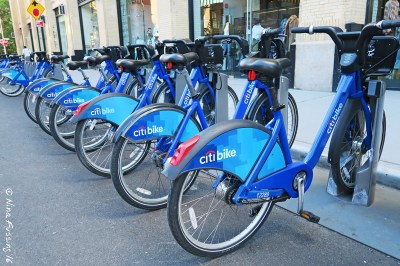 A line of Citibikes at a docking station