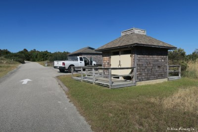 View of shower facilities (front) and toilets (back)