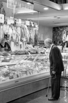 A customer eyes the wares at a local shop
