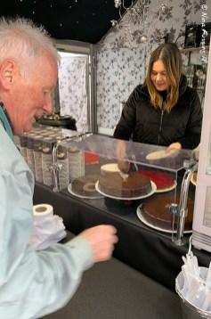 Dad samples a home-made chocolate cake