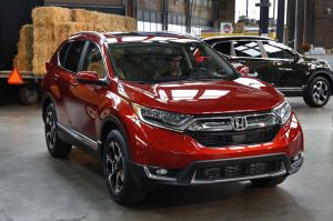 This Wednesday, Oct. 12, 2016, photo shows the 2017 Honda CR-V, in Detroit. America's family car is no longer the Toyota Camry or some other midsize car. It's the Honda CR-V, a compact SUV, that's getting its first overhaul since 2012. (AP Photo/Paul Sancya)