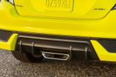 The 2019 Honda Civic Coupe Sport has a sport muffler capped by a wide, center-mounted chrome exhaust finisher. TNS