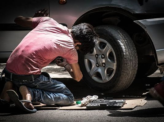 Car repairing with your kid: Build a car emergency kit and check engine filters