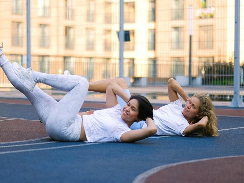 Women doing seated bicycle stretch