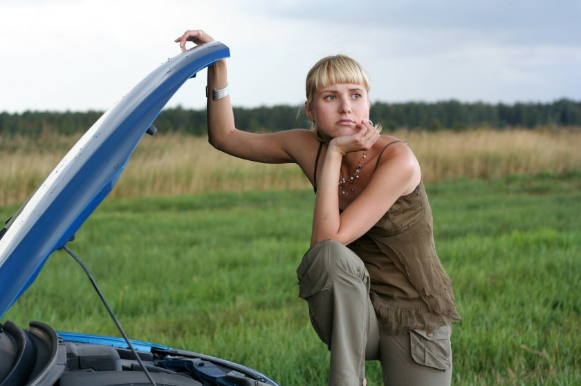 Young Woman With Her Broken Car