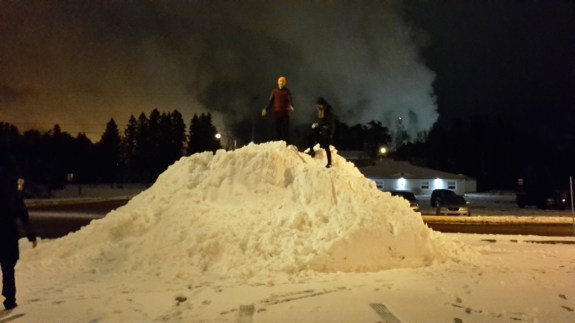 Playing on mountains of snow