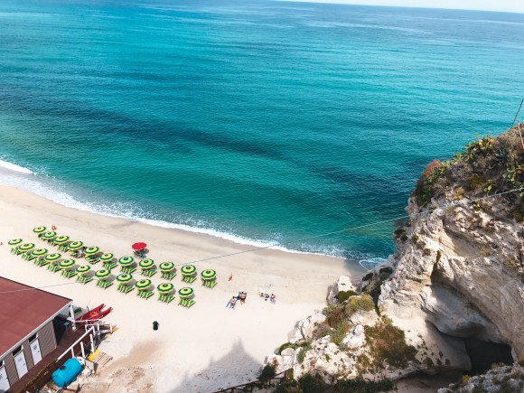 beach in tropea, italy with sunbeds