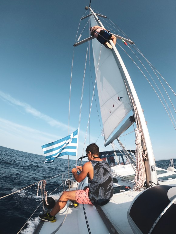 sailboat and greek flag