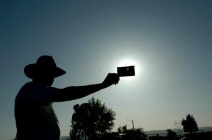 Viewing an eclipse through an eclipse viewer.