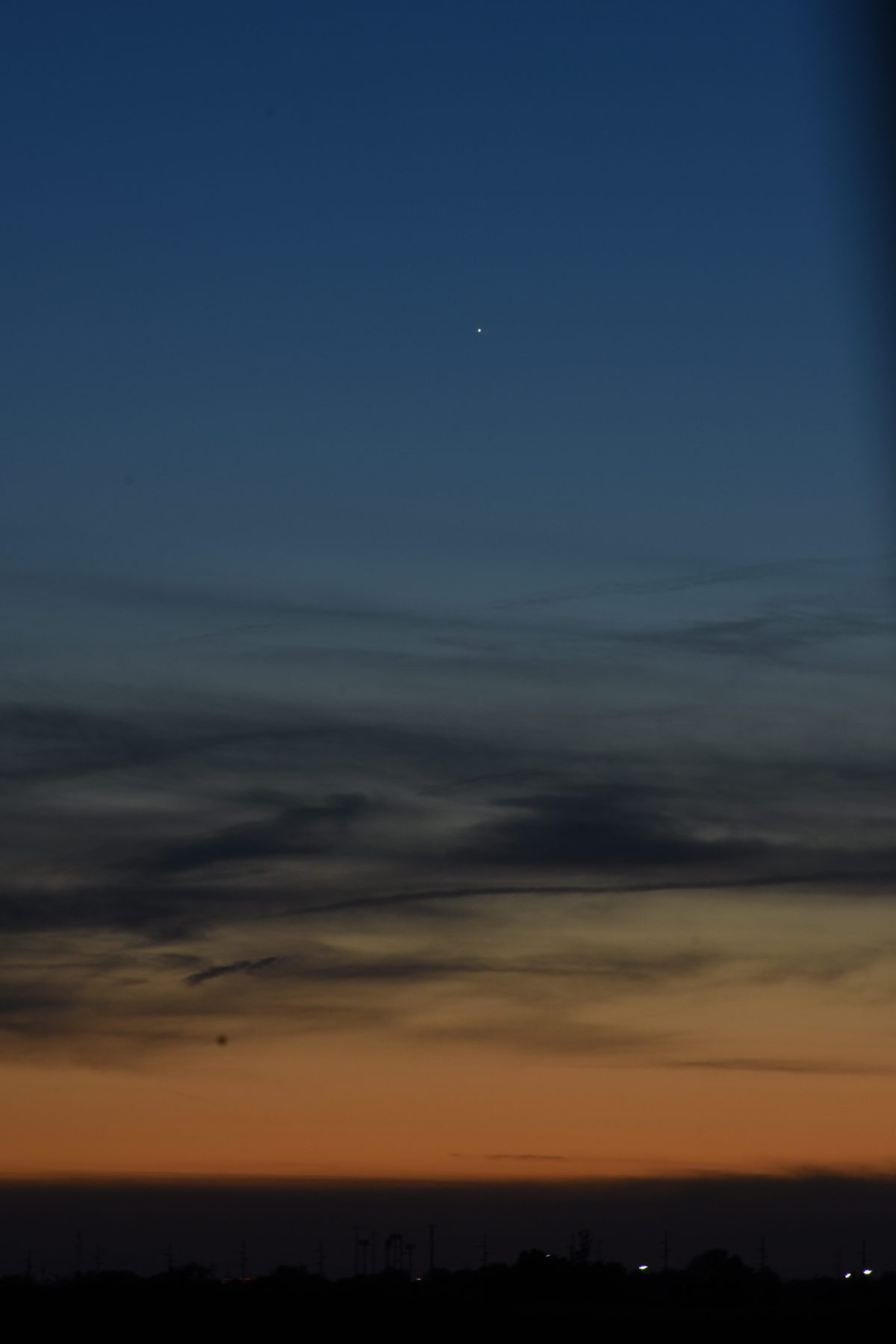 2021, May 29: Brilliant Venus shines from the west-northwest after sunset. Mercury, with some magnification, is visible to the lower right of Venus.