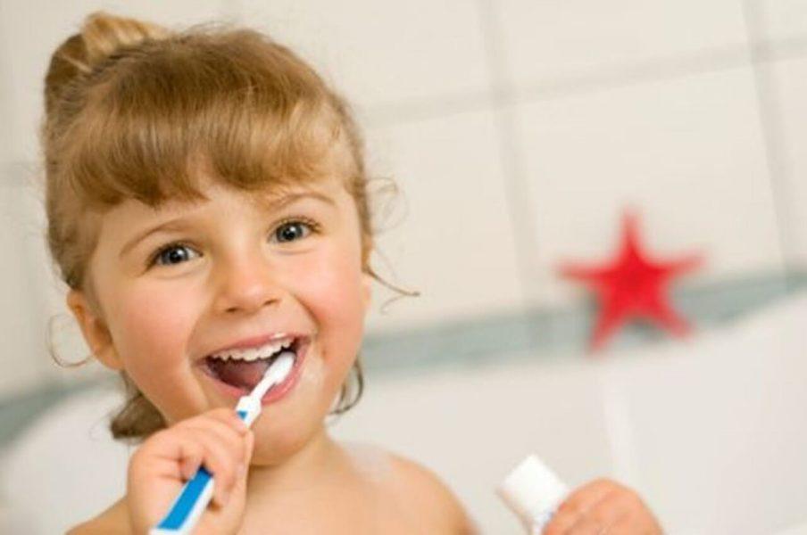 Girl brushing her teeth for good health