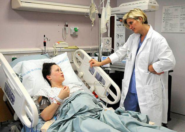 Midwife checks on mom