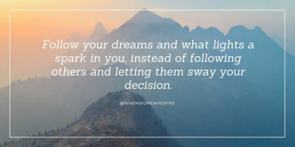 Inspirational quote about following your dreams with a hilltop and mountain peaks behind it