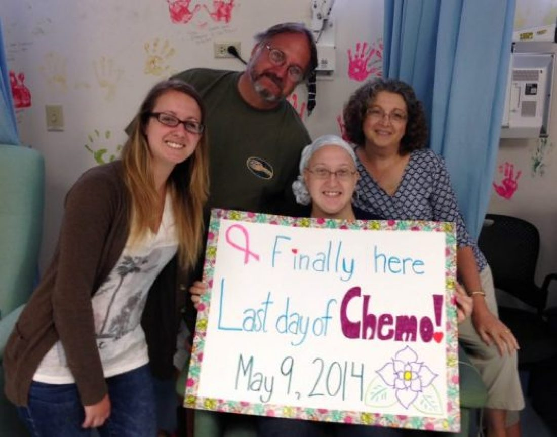 About 1 in 8 women get breast cancer, including Amanda shown here holding chemo sign