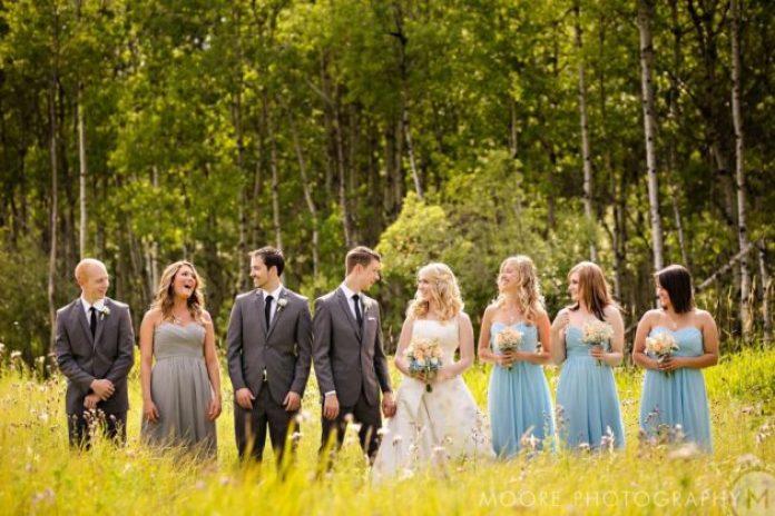 A trendy gray groomsmaid dress in a summer wedding