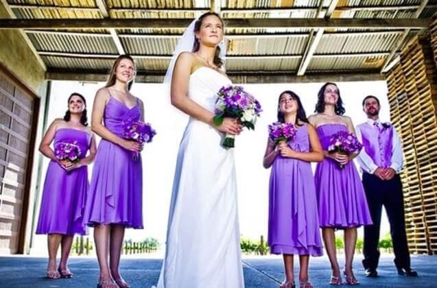 The bridesmen wear a suit matching the lavender bridesmaids' dresses