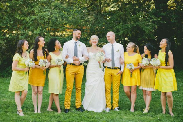 Bridesmen and the rest of the wedding party have fun in yellow