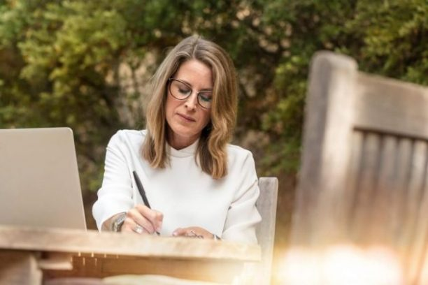 Writing a personal note of encouragement is one great way to celebrate women