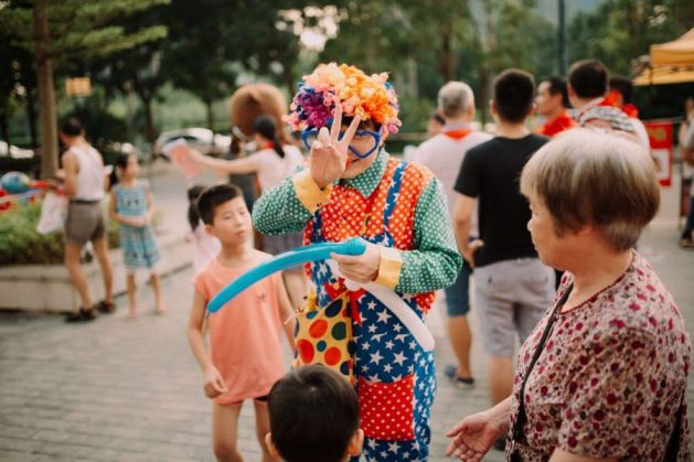 Clown performs for kids at wedding