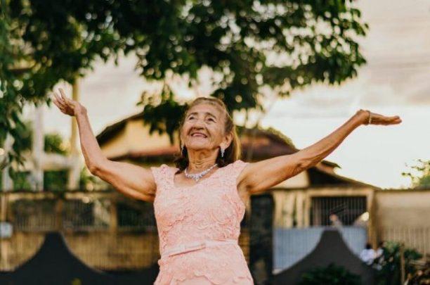 Happy older woman feels sense of community