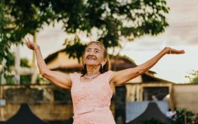 Happy older woman feels sense of community