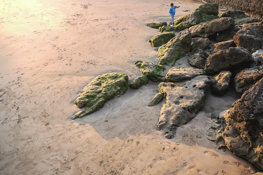 Child Playing On Beach In Essaouira Morocco