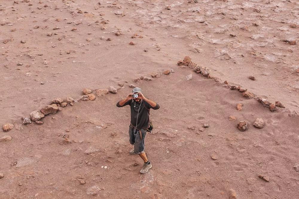 Grado 10 Guide Taking a Photo in the Valle de la Luna