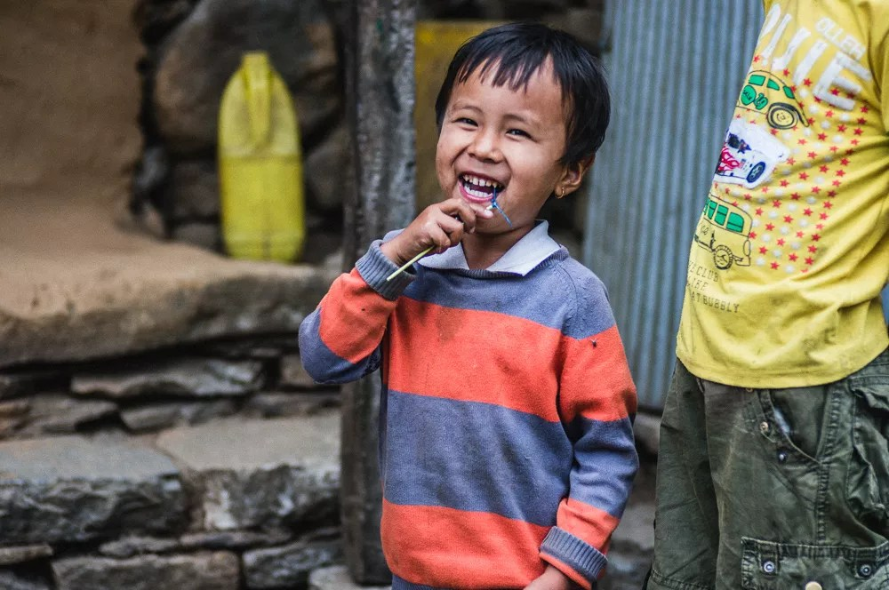 Child Laughing In Nepal Village Annapurna Circuit