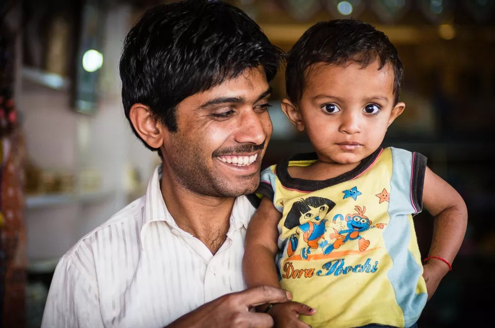 India Shopkeeper Portrait With Son