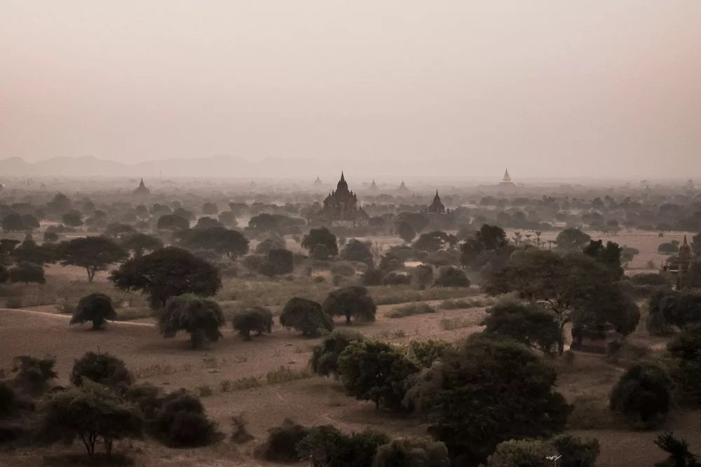 Hazy sunrise over pagodas in Bagan
